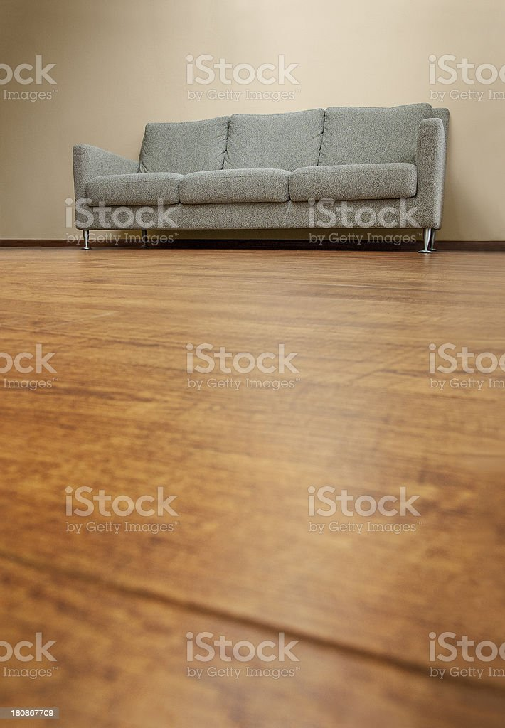 Fabric couch on wooden floor stock photo