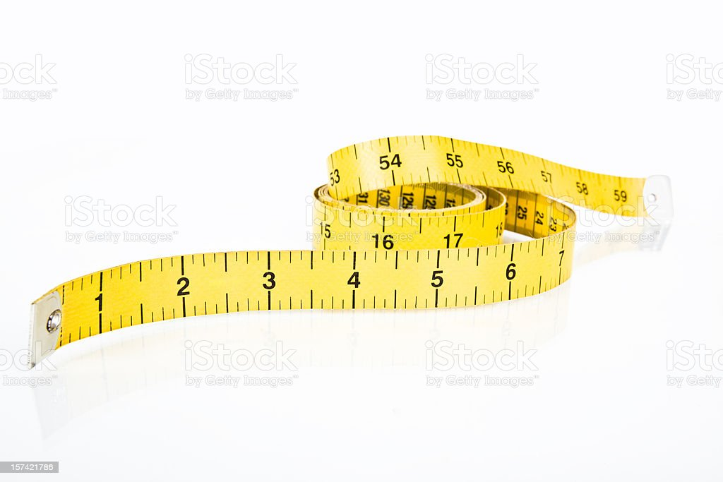 Fabric measuring tape in yellow  royalty-free stock photo