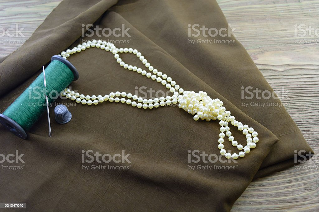 fabric of a thread and necklace stock photo