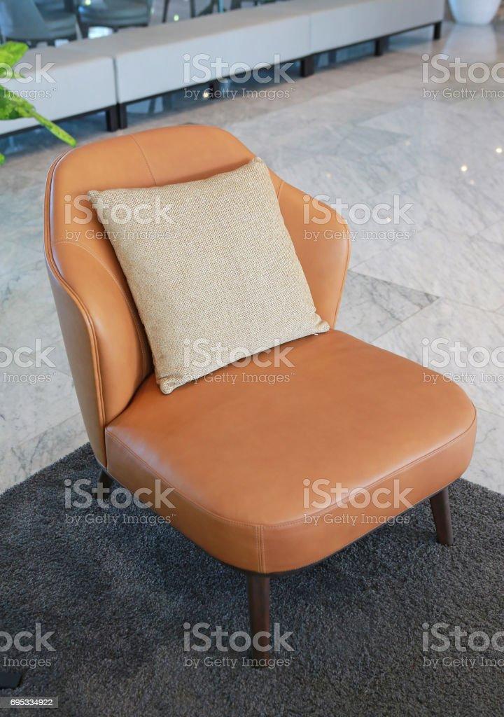 Fabric pillows on leather sofa. stock photo