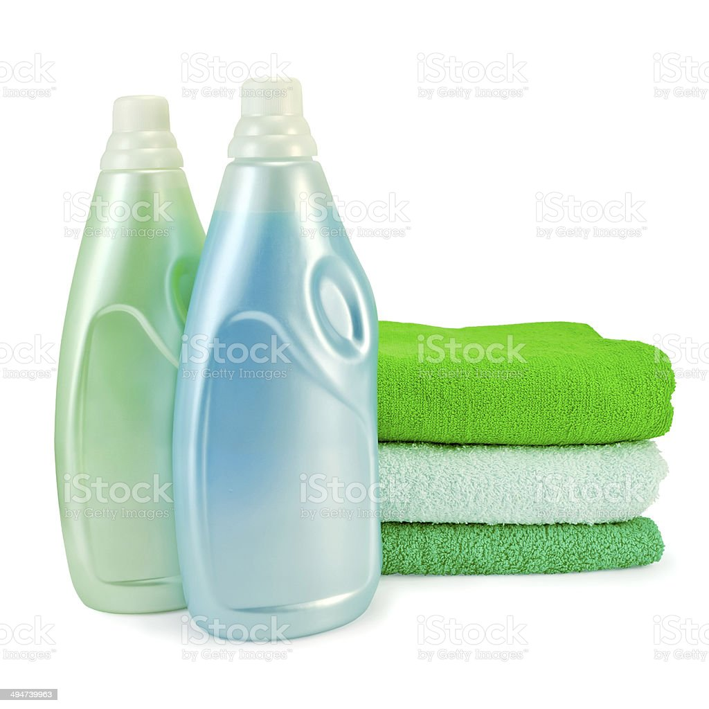 Fabric softener in two bottles and towels stock photo