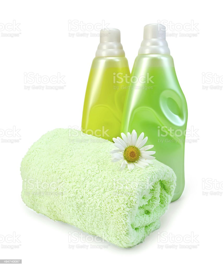 Fabric softener in two bottles with chamomile stock photo