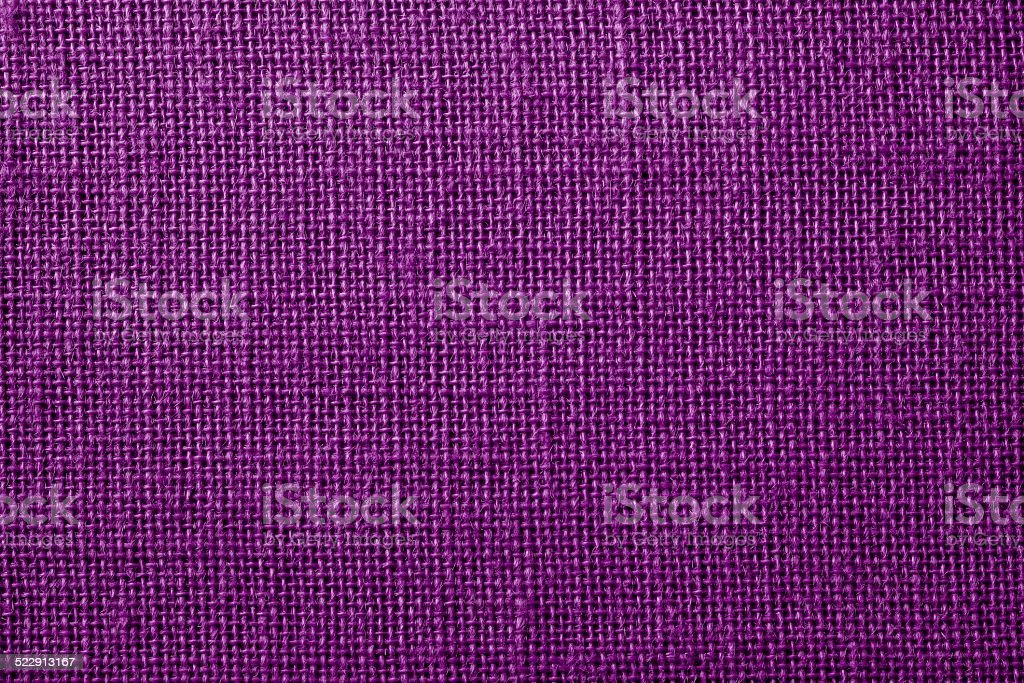 fabric with crisscross fibers of dark lilac color stock photo