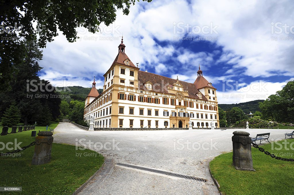 Facade and driveway of Eggenberg castle in Graz royalty-free stock photo