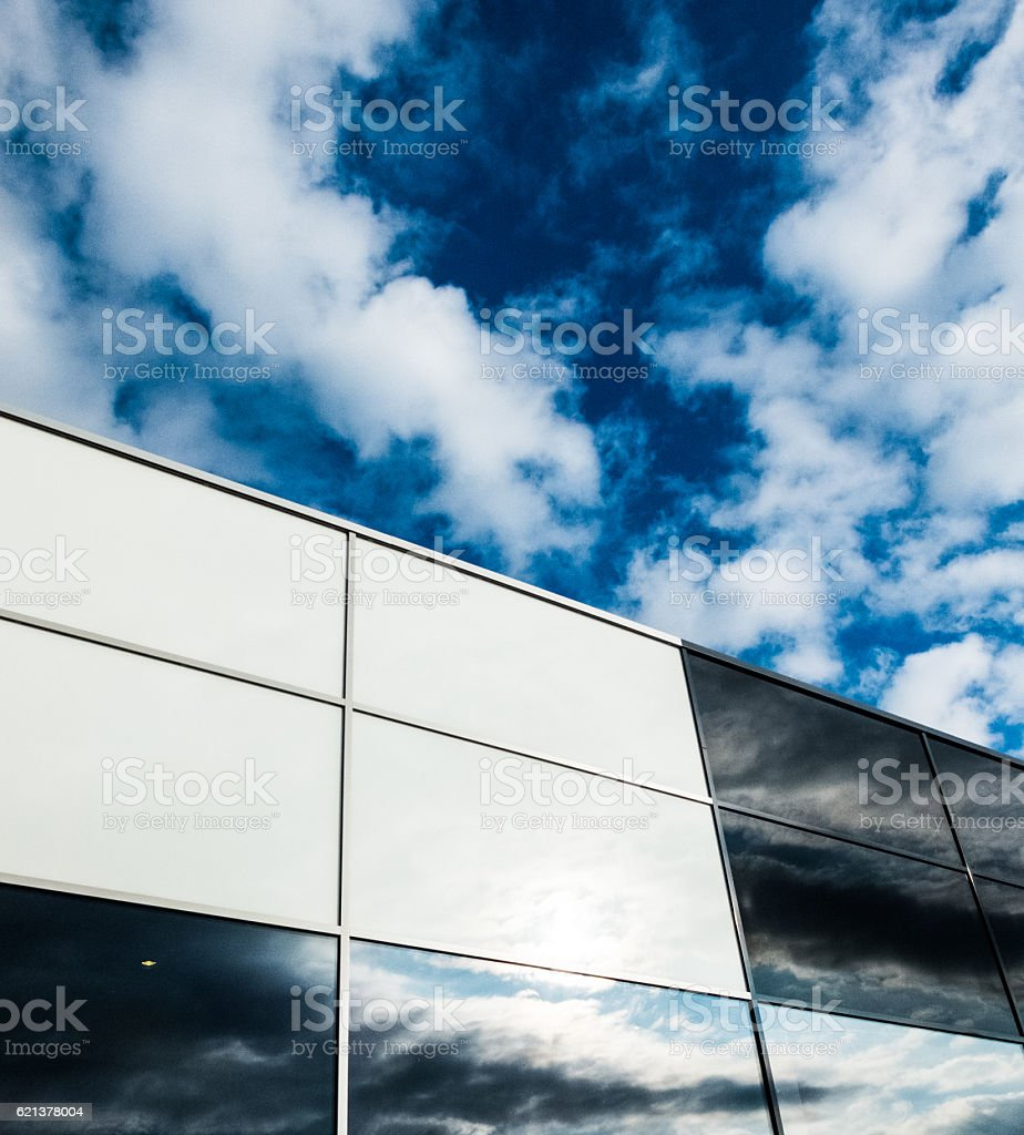 facade black and white building with blue sky and cloud stock photo