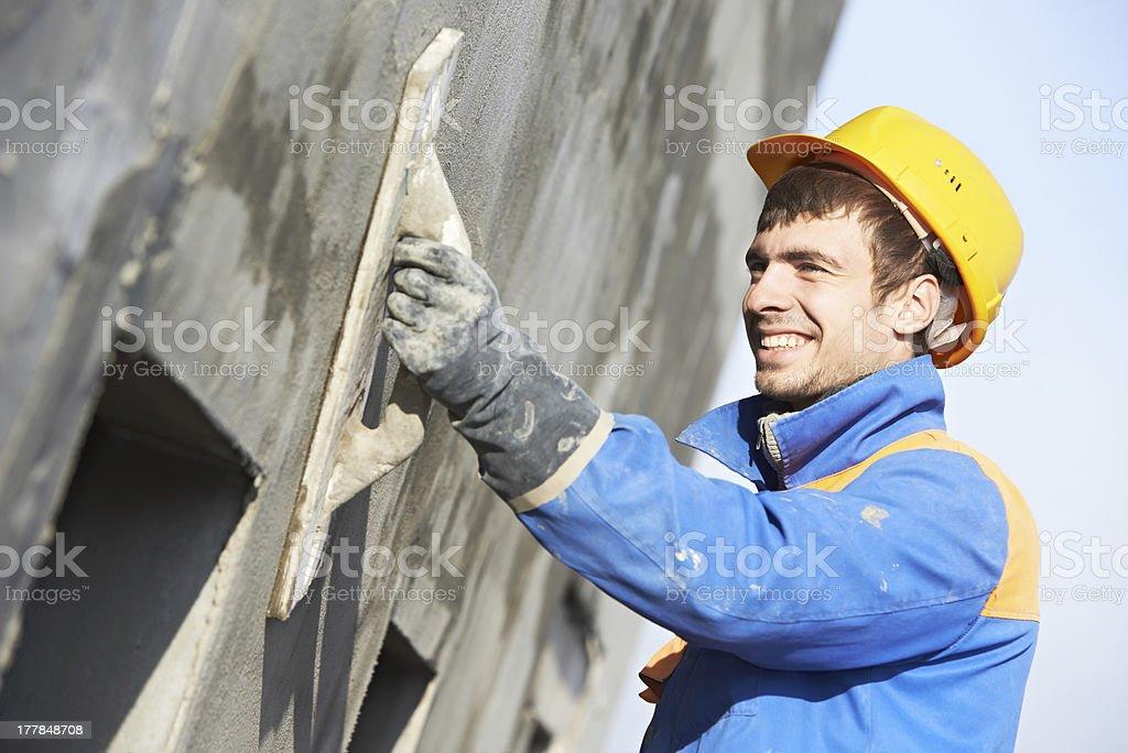 facade builder plasterer at work royalty-free stock photo