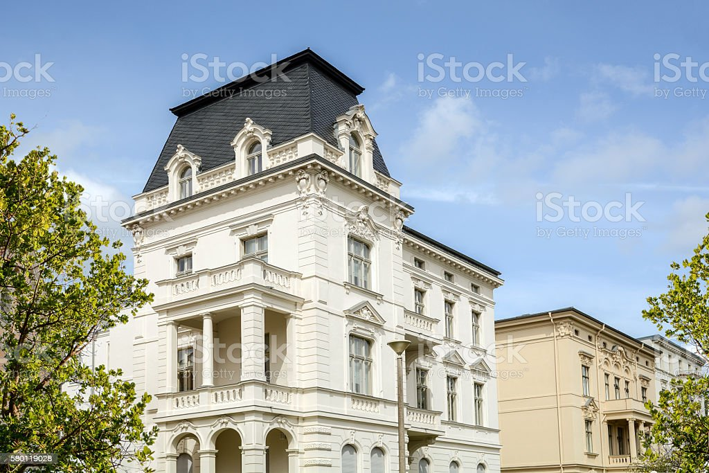 Facade of a classical villa in the city stock photo