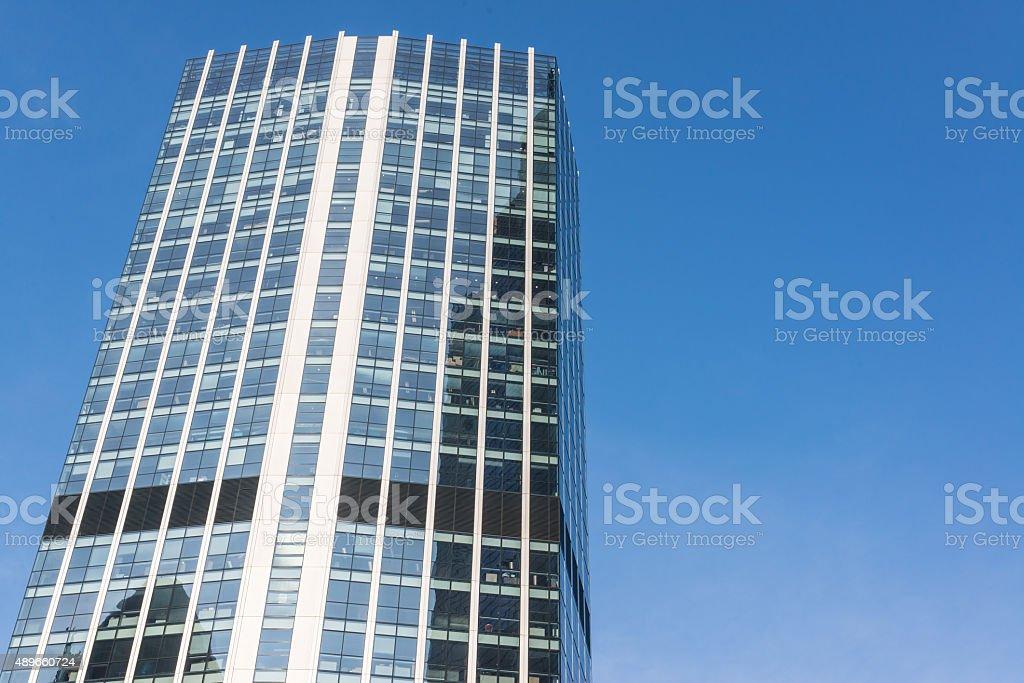 Facade of a glass skyscraper empty blue sky in background stock photo