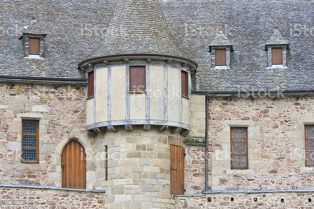 Facade of a medieval castle with tower stock photo