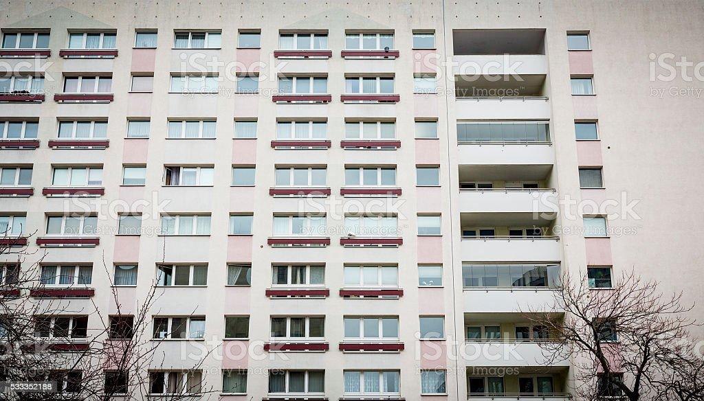 facade of a plattenbau at Berlin Alexanderplatz stock photo