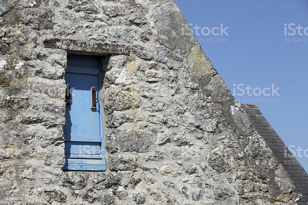 Facade of a stone house stock photo