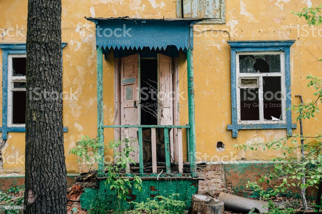 Facade of abandoned house, demolished ruined house stock photo