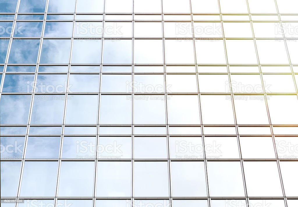 Facade of an office building with reflected sky stock photo