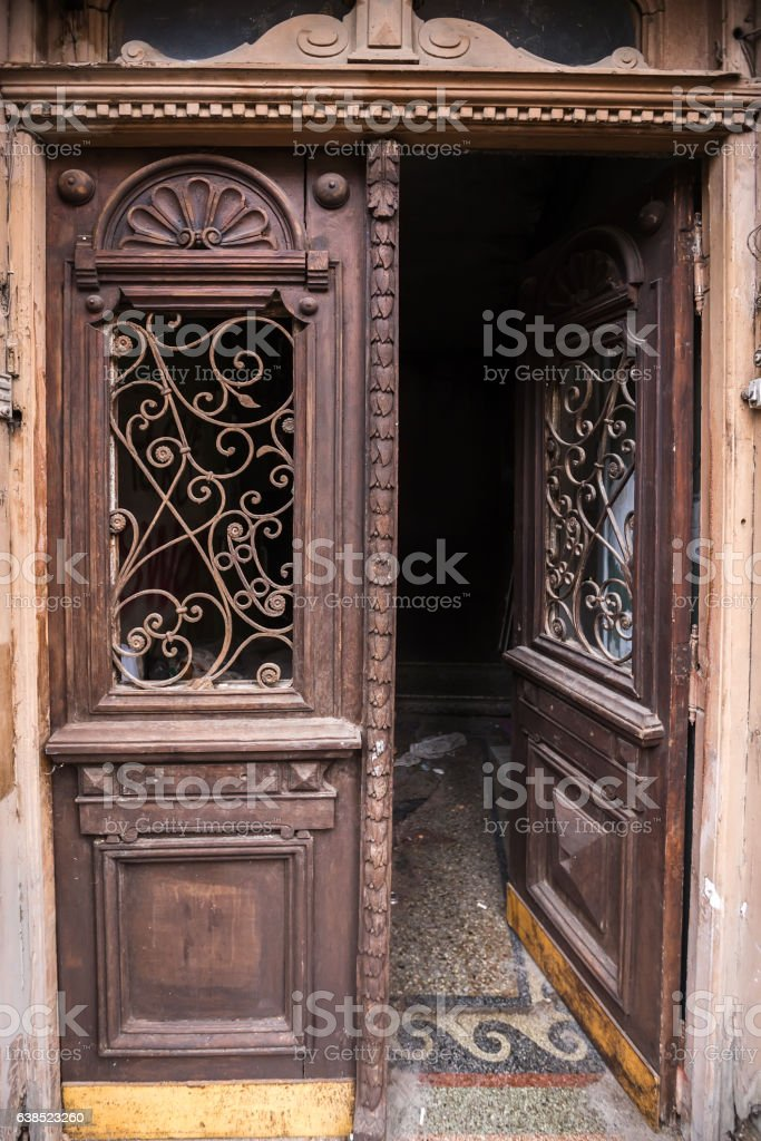 facade of an old building door with forged iron in stock photo