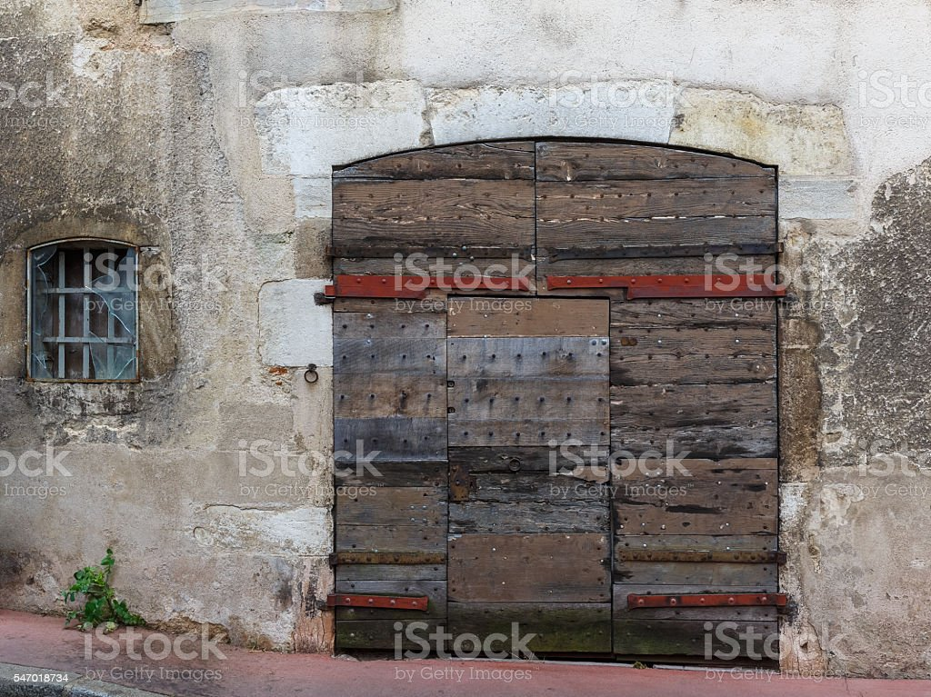 Facade of an old building with wooden gate stock photo