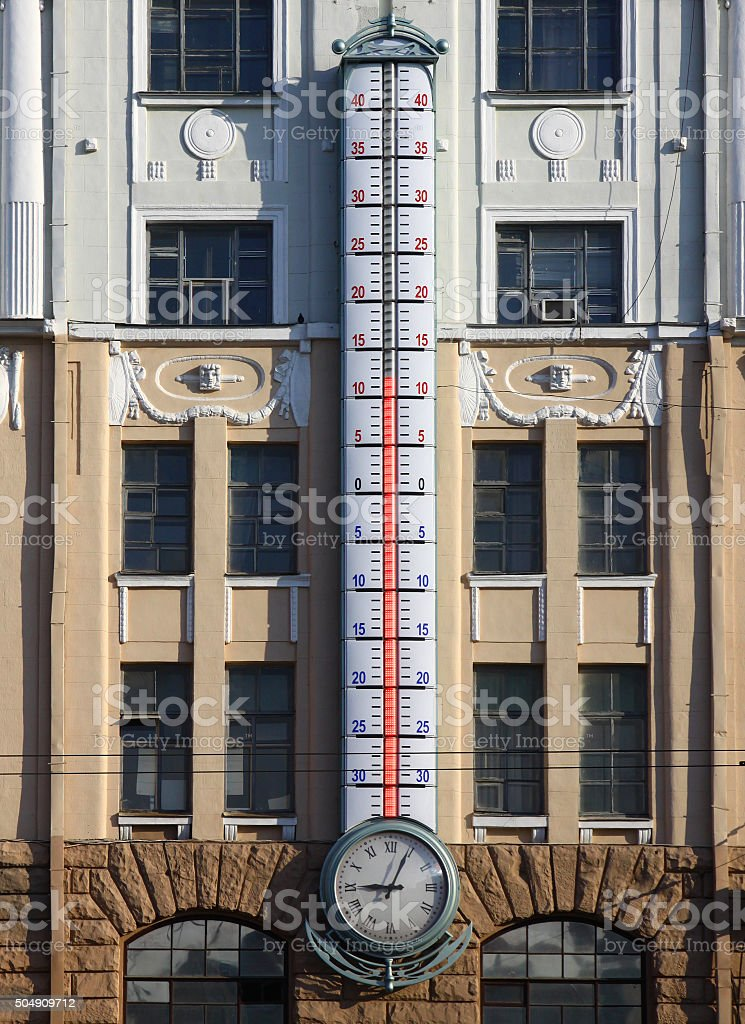 Facade of building with giant outdoor thermometer stock photo
