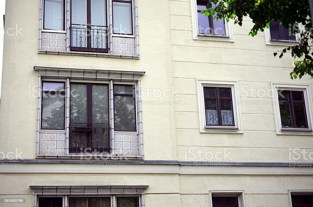 facade of building with windows of socilalism times in berlin stock photo