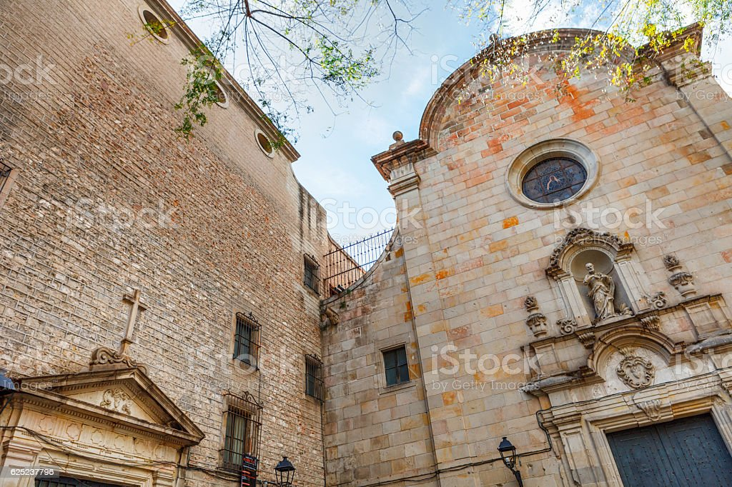 facade of church and Placa de Sant Felip Neri, Barcelona stock photo