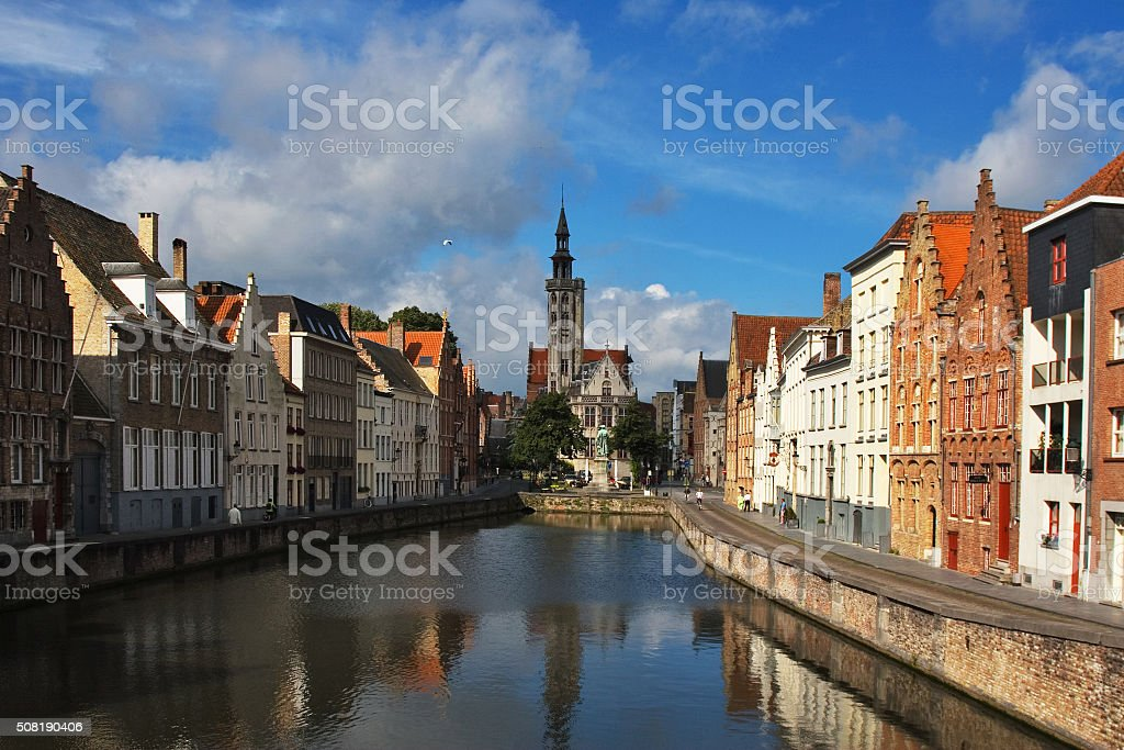 Facade of flemish houses and canal in Brugge stock photo