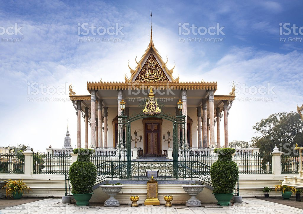 Facade of silver pagoda with gold roof and white columns stock photo
