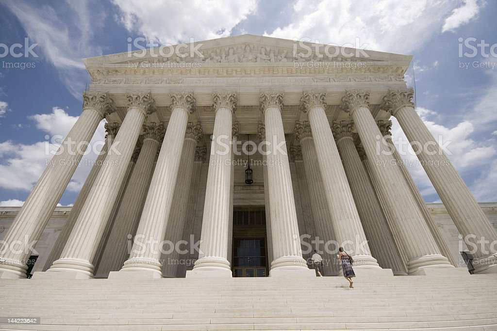 Facade of Supreme Court Building Washington DC Blue Sky stock photo
