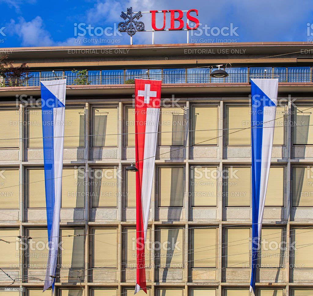 Facade of the UBS building in Zurich, decorated with flags stock photo