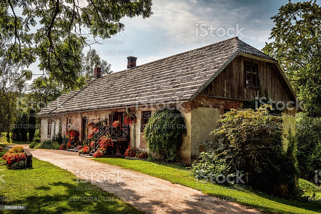 Facade of traditional stone Latvian house stock photo