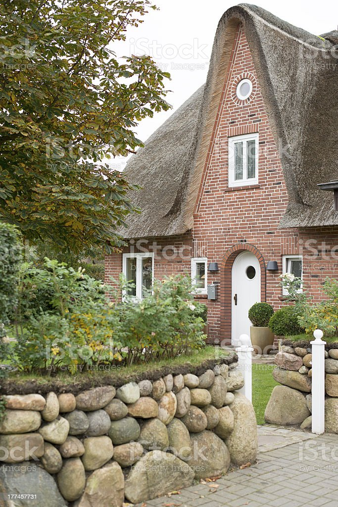 Facade of typical traditional home on island Sylt, Germany. stock photo