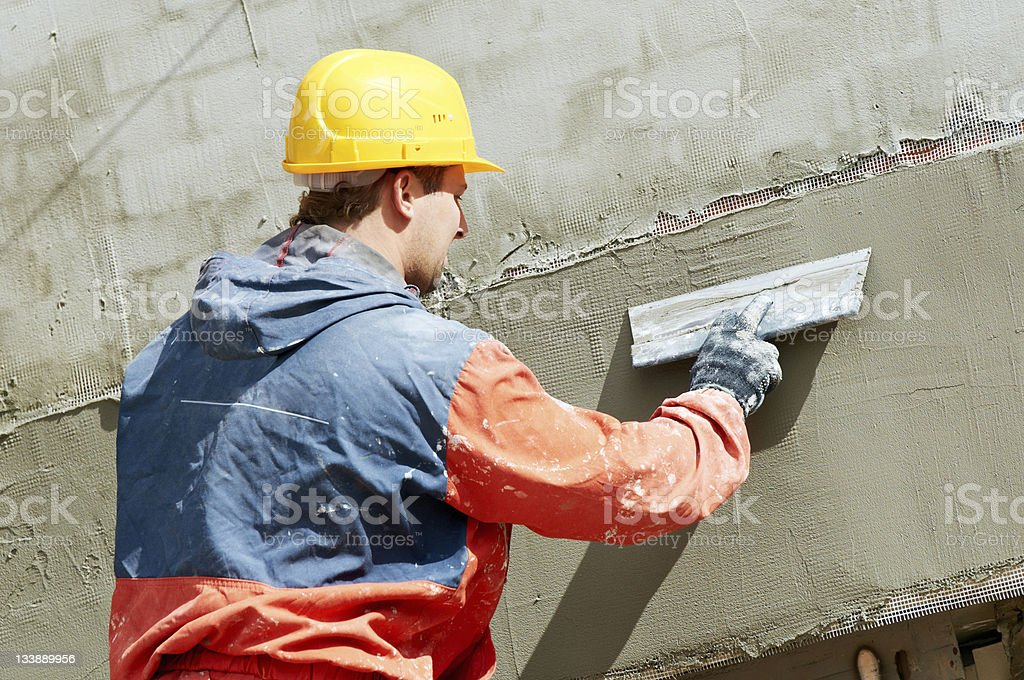 Facade Plasterer at work royalty-free stock photo