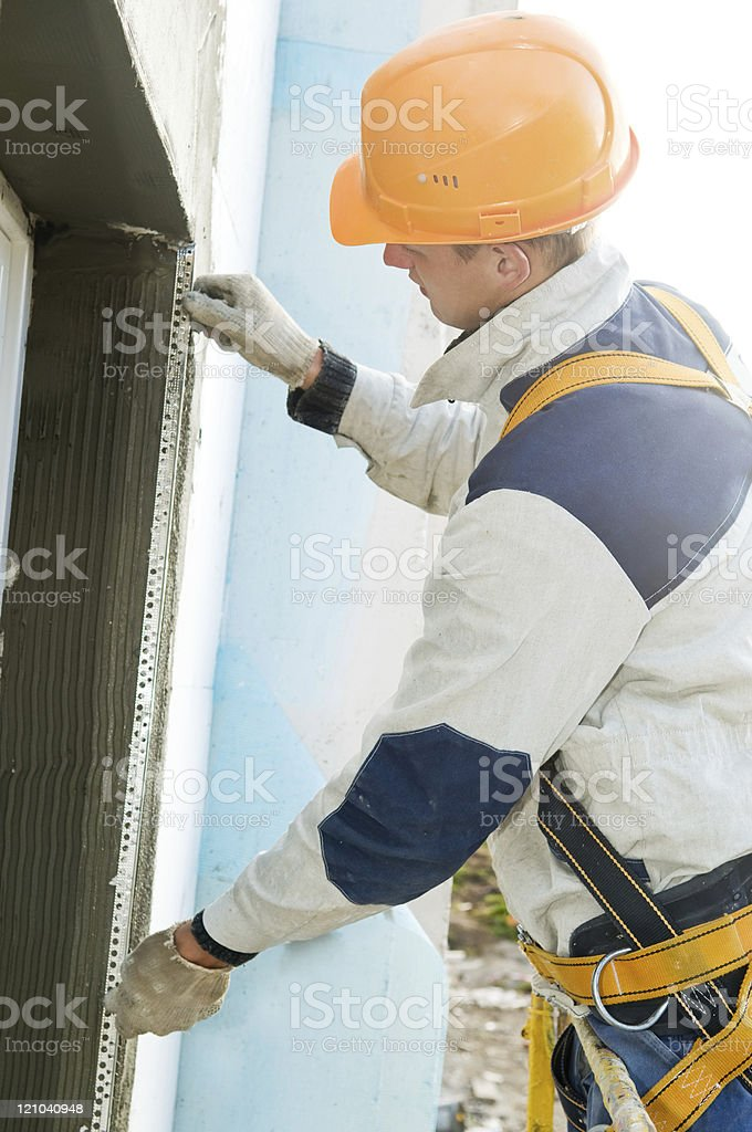 facade stopping and surfacer works stock photo