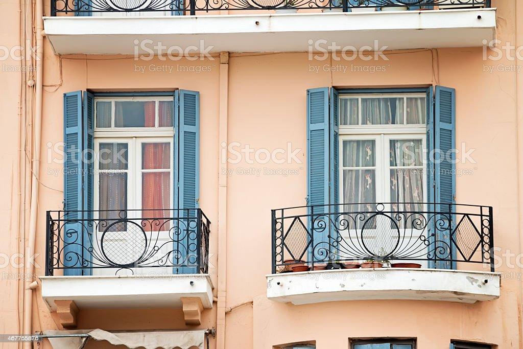 Facade with balconies in Greece stock photo