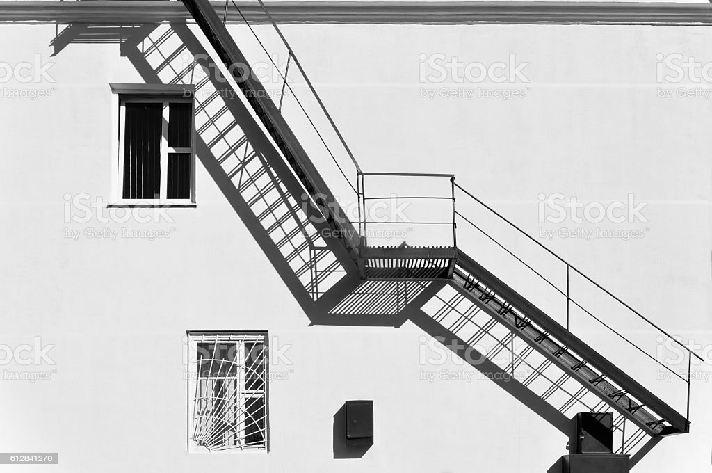 Facade with metal fire staircase. stock photo