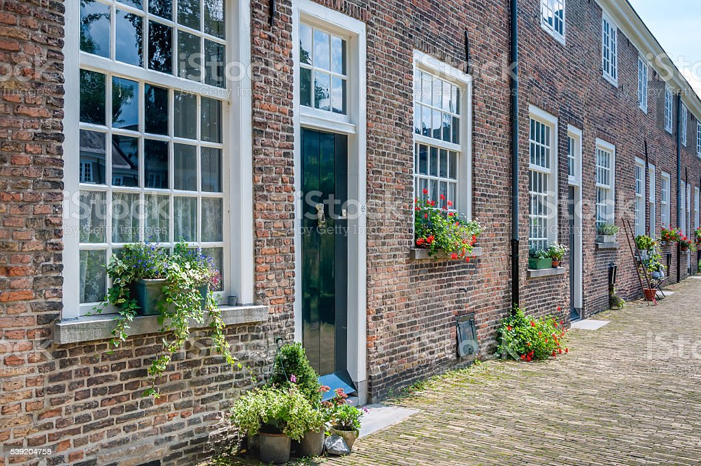 Facades historic Beguinage in the Dutch city of Breda stock photo