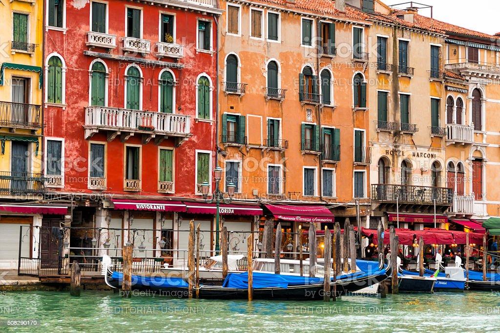 Facades in Italy and gondolas stock photo