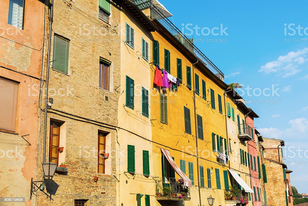 facades of old buildings in Siena, Italy stock photo