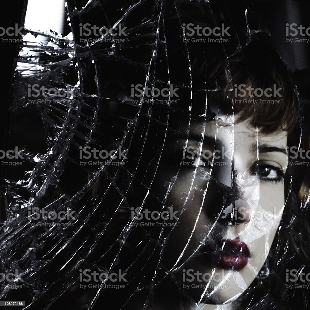 Face Behind Broken Glass royalty-free stock photo