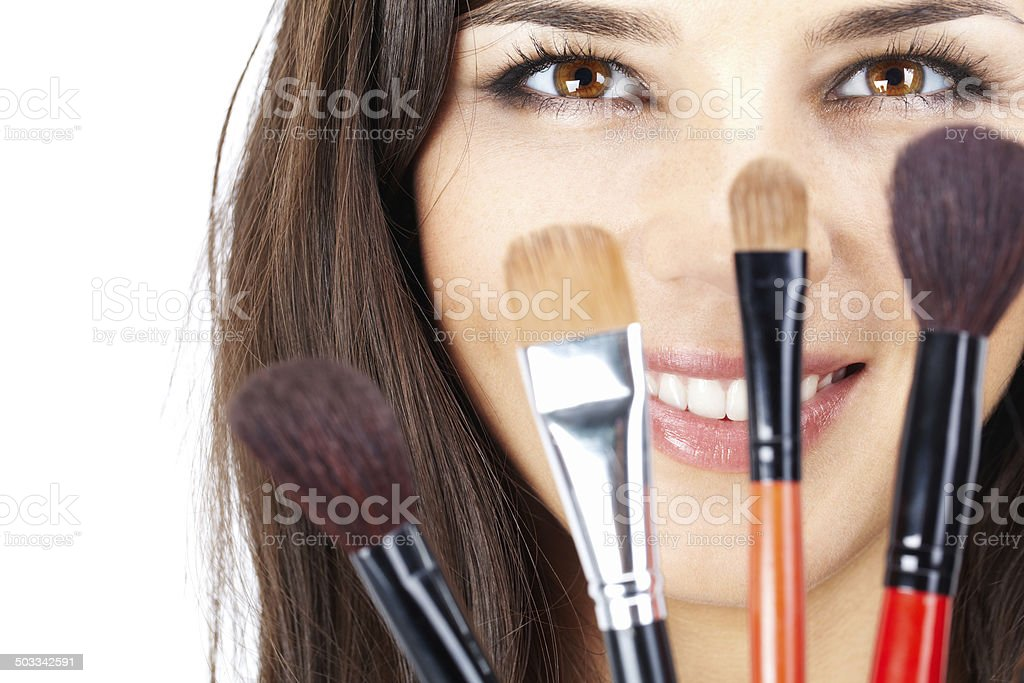 Face behind brushes stock photo