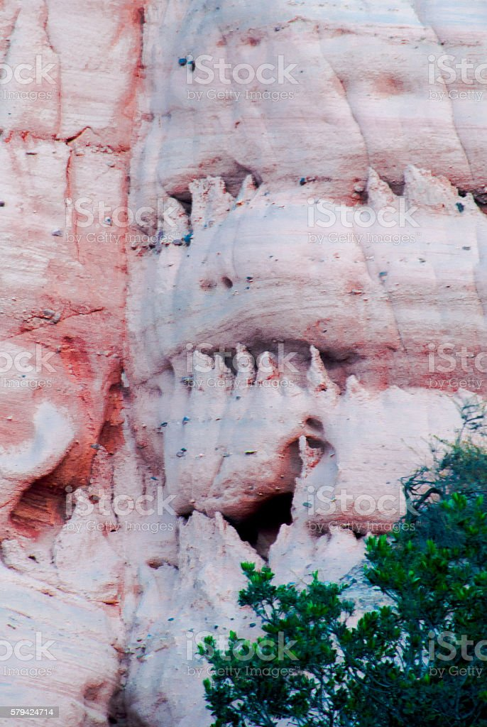 face carved into cliff face by erosion stock photo