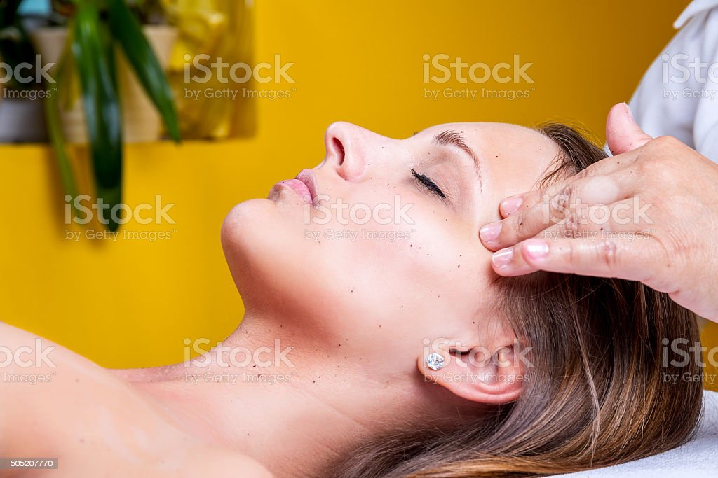Face cleaning in a beauty salon. stock photo