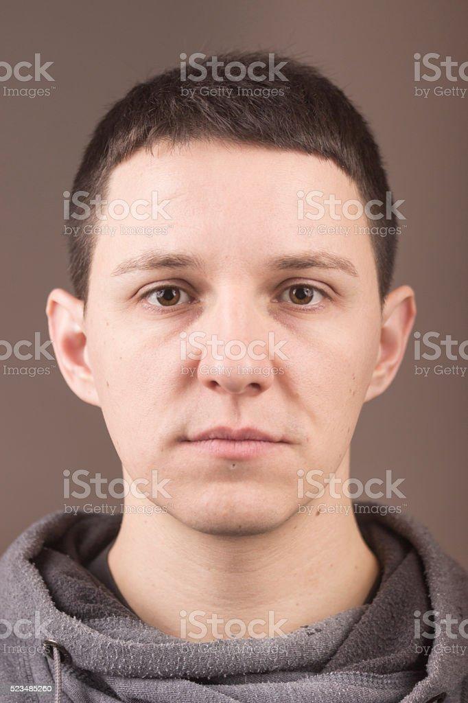Face close up portrait , like mug shot, no expression. Cacusian young...