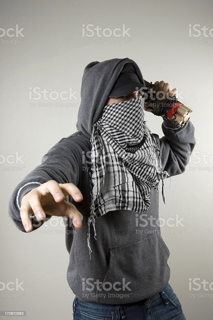face covered demonstrator with time bomb royalty-free stock photo