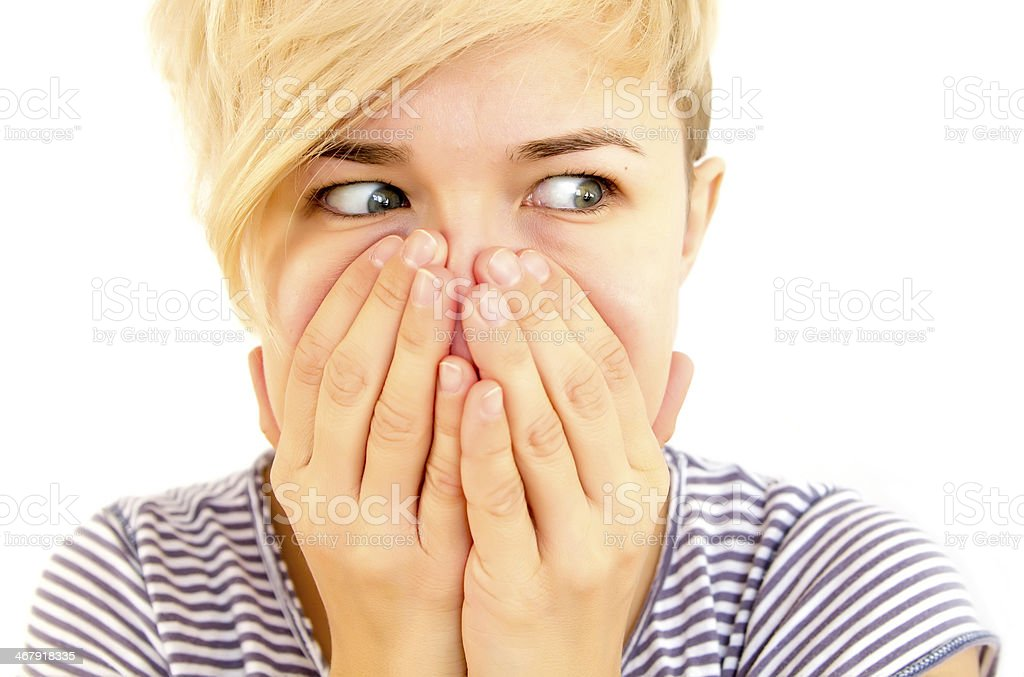 face covered with hands stock photo