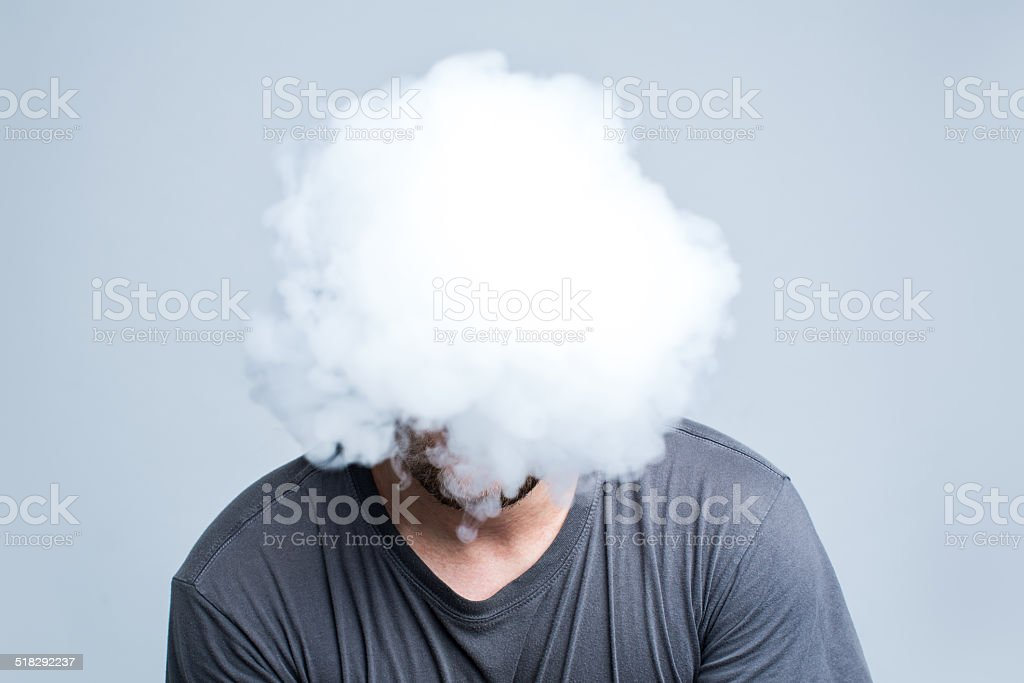 Face covered with thick smoke stock photo
