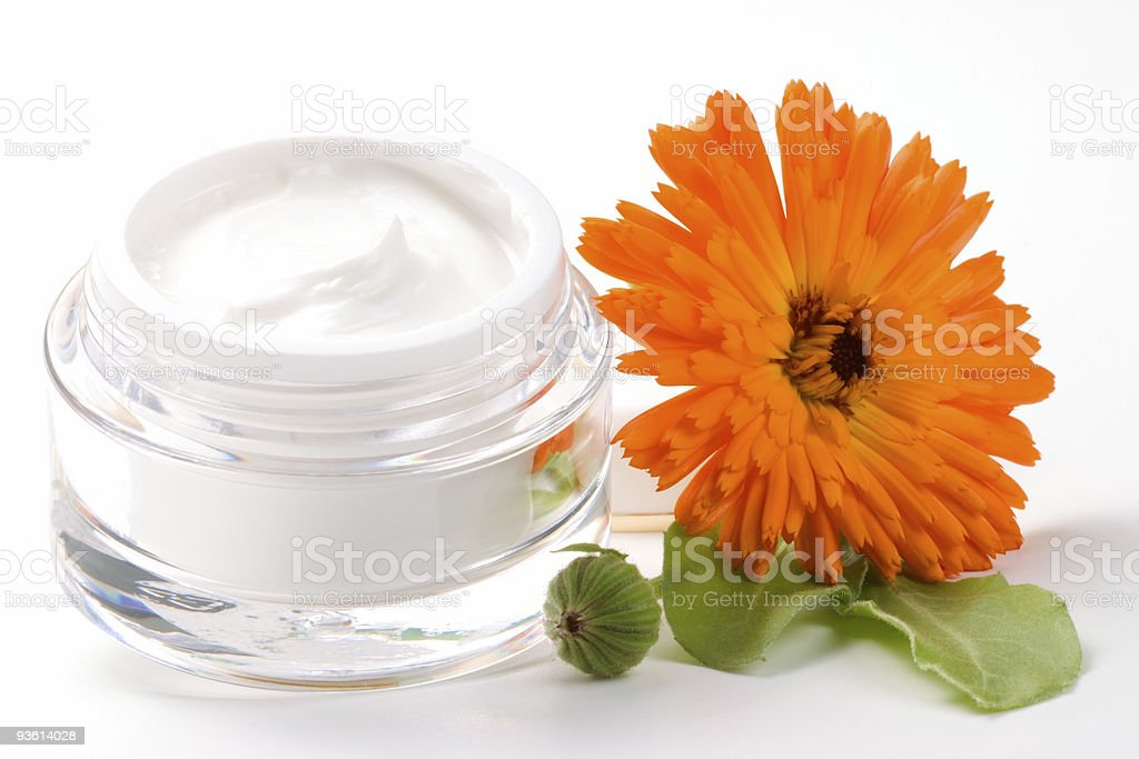 Face cream and calendula flower stock photo