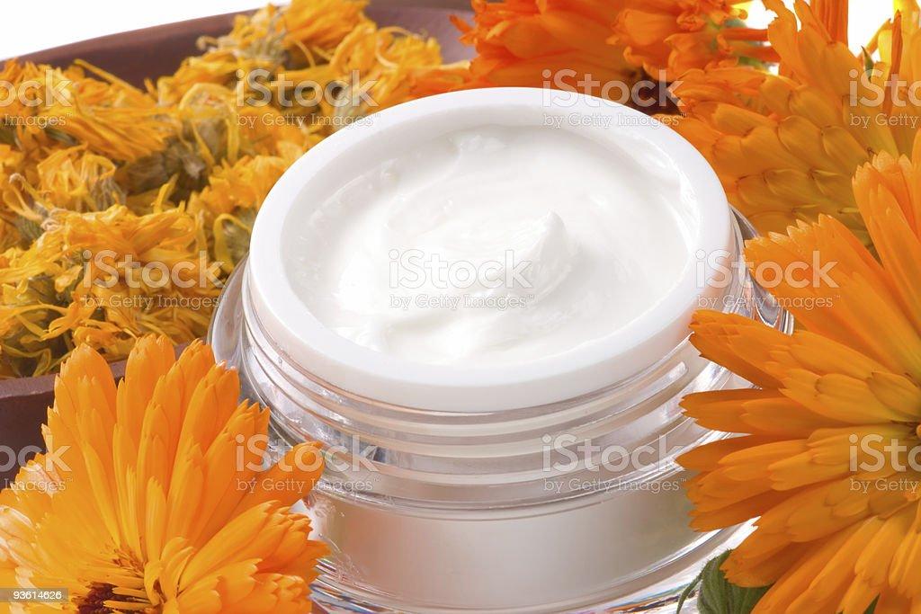 Face cream and calendula flowers stock photo