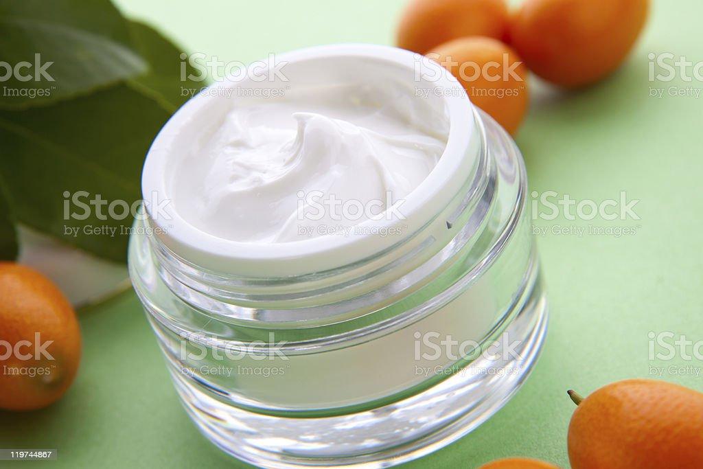Face cream and fresh cumquats stock photo