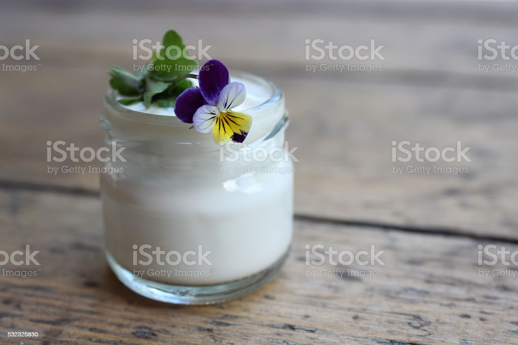 Face cream and violet flower stock photo