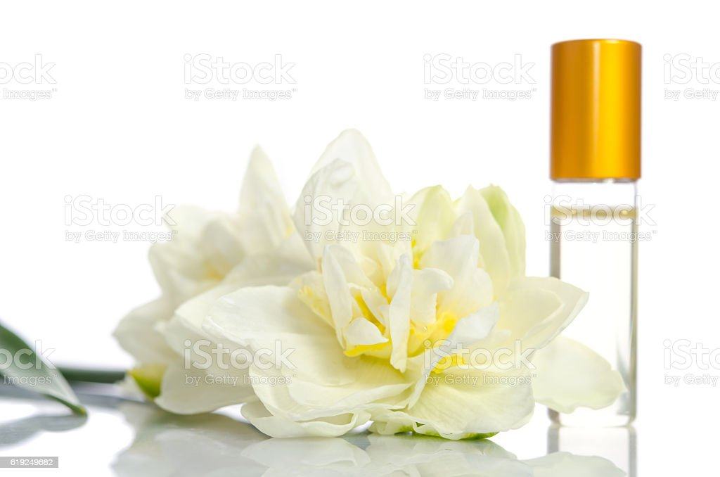 Face cream bottle with flowers isolated on white stock photo