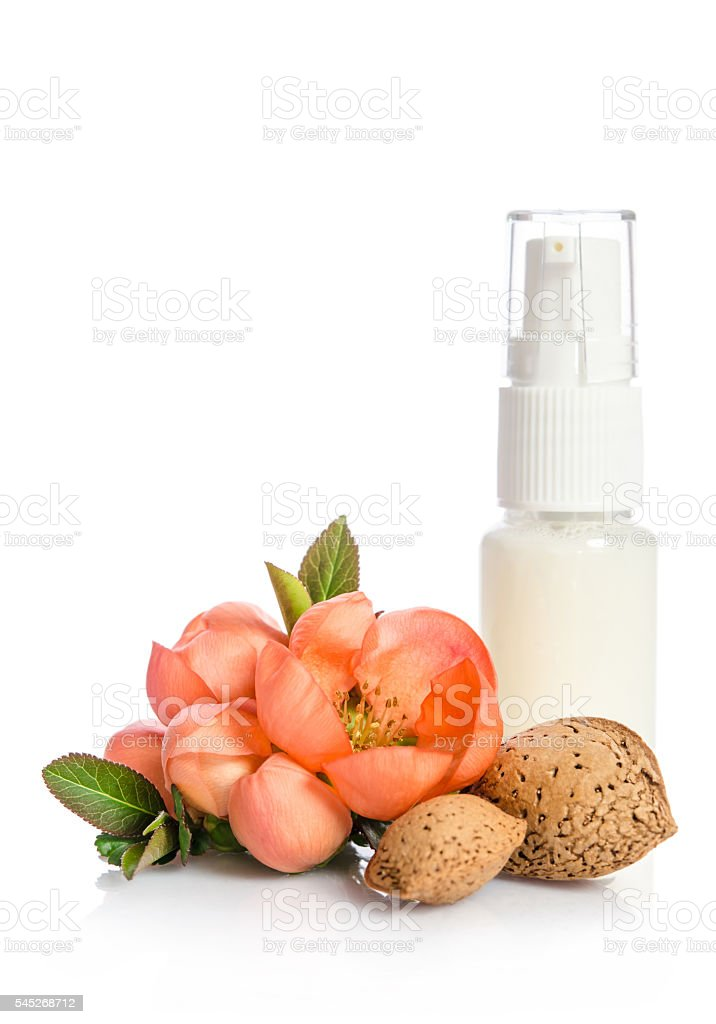 Face cream bottle with pink flower isolated on white stock photo