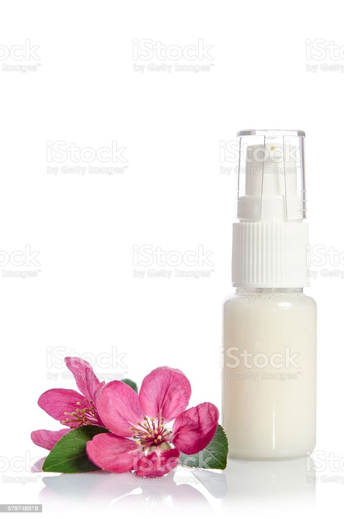 Face cream bottle with pink rose isolated on white stock photo